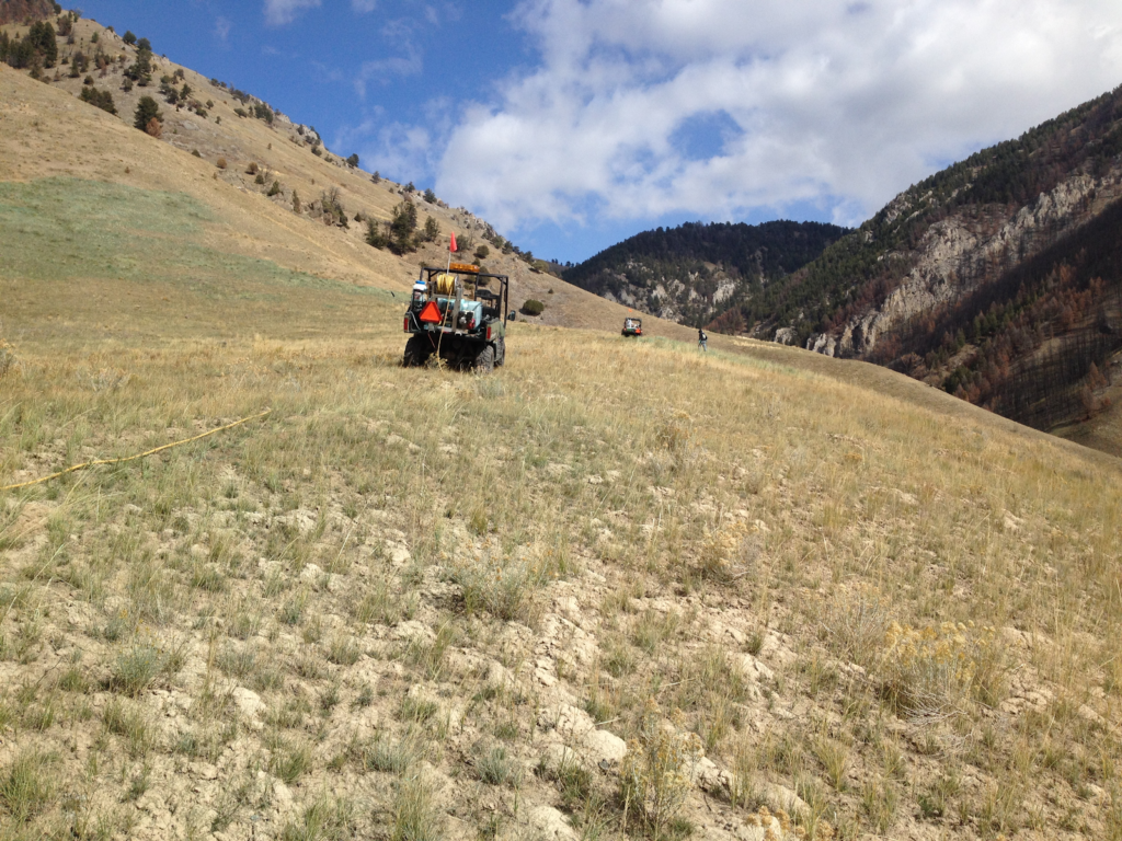 JHWMA Cheatgrass Mitigation Project - Razr Train From Behind on Mountain Trail image